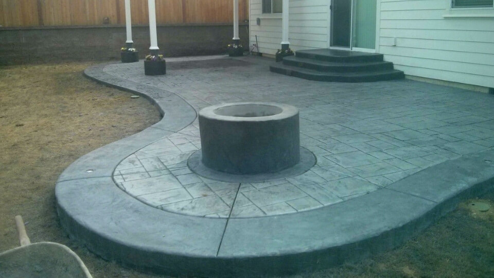 back patio with fire pit and seating area grey concrete