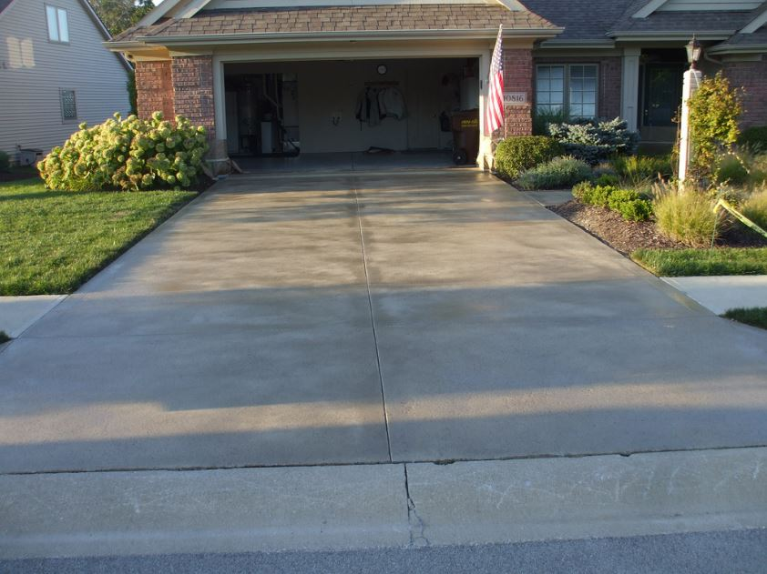 colored concrete driveway in front of suburban home