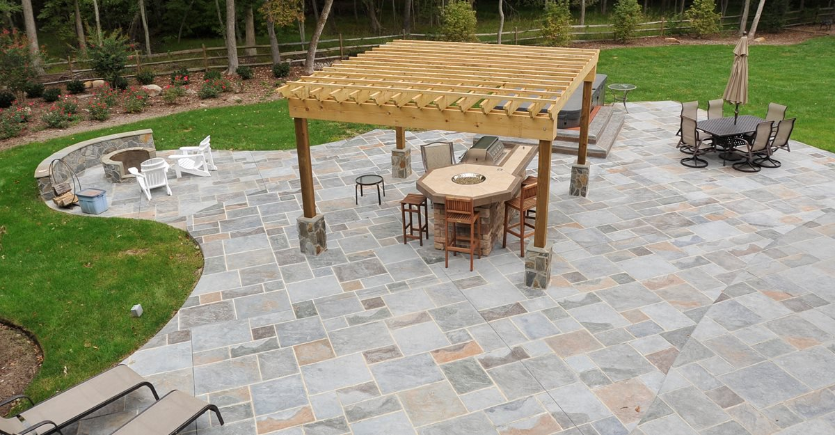 back patio with pergola and flagstone