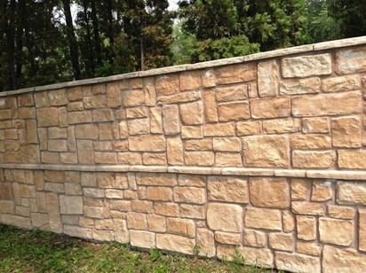 five foot high Stone retaining wall randomly