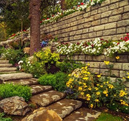 Retaining walls making a multi-level flower beds with stone stairs