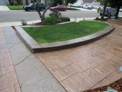 Stamped concrete driveway gives a fresh look out front of a home